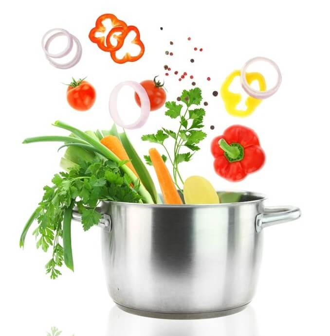 18422347 - fresh vegetables falling into a stainless steel casserole pot